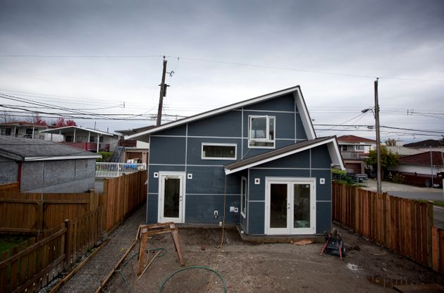 A laneway house under construction on Knight Street in Vancouver, Oct. 29, 2010. The city's rules allowing...