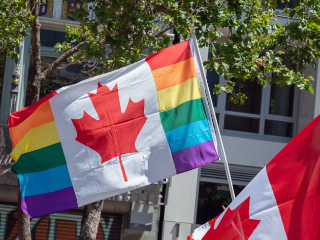 A Canadian Pride flag flies at a Pride festival.