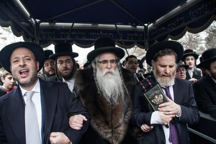 Rabbi Chaim Rottenberg (center) and others celebrate the arrival of a new Torah scroll in Monsey, New York, on Dec. 29, 2019.