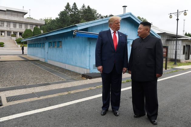 FILE - In this June 30, 2019 file photo, President Donald Trump meets with North Korean leader Kim Jong...