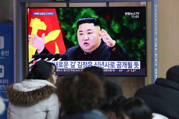 People watch a TV screen showing an image of North Korean leader Kim Jong Un during a news program at...