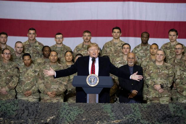 FILE - In this Nov. 28, 2019 file photo, President Donald Trump, center, with Afghan President Ashraf...