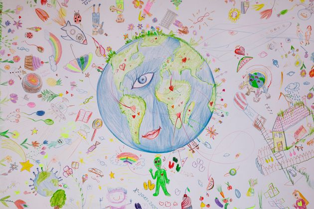 Child's drawing of the planet Earth (people, rainbow,