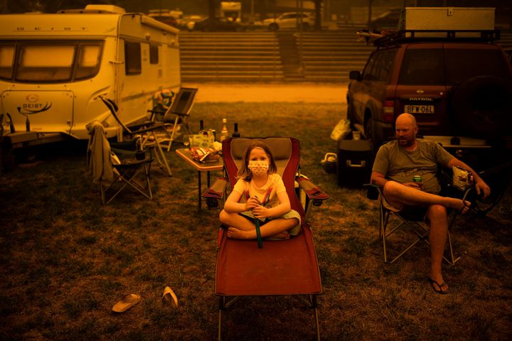 Amy and Ben Spencer sit at the showgrounds in the southern New South Wales town of Bega where they are camping after being evacuated from nearby sites on Dec. 31, 2019.