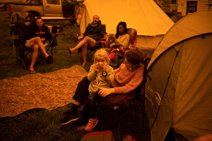 Evacuees at the showgrounds in the southern New South Wales town of Bega sit and wait on Dec. 31, 2019.