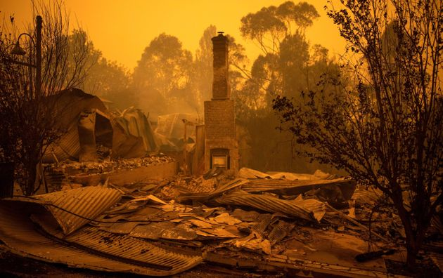 The remains of burnt out buildings are seen along main street in the New South Wales town of Cobargo...