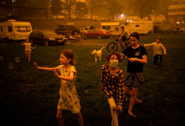 Children play at the showgrounds in the town of Bega where they are camping the fires forced them from...