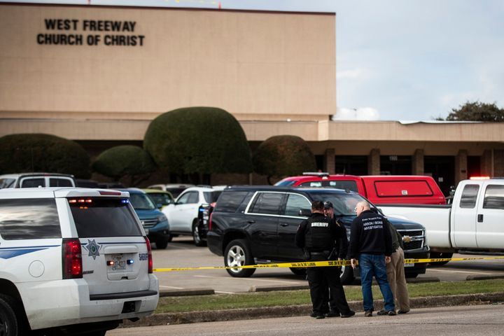 Police and fire department officials surround a scene of a shooting Sunday, Dec. 29, 2019, at West Freeway Church of Christ i