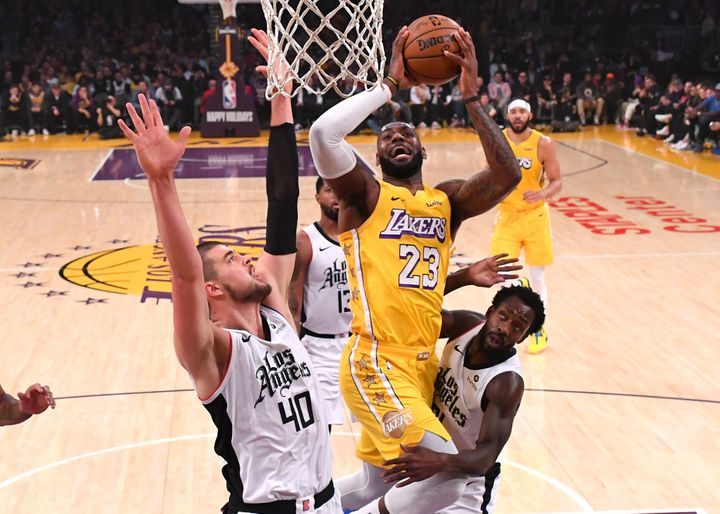 LeBron James goes for a basket in the first half of the game against the Los Angeles Clippers at the Staples Center on Decemb