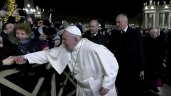 Pope Francis Pulls Himself Away From Woman Who Yanked His