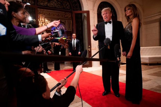 US President Donald Trump and First Lady Melania Trump speak to the press outside the grand ballroom...