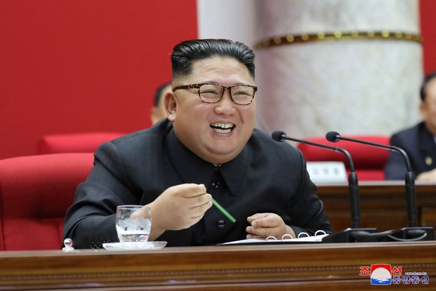 North Korean leader Kim Jong Un attends the 5th Plenary Meeting of the 7th Central Committee of the Workers'...