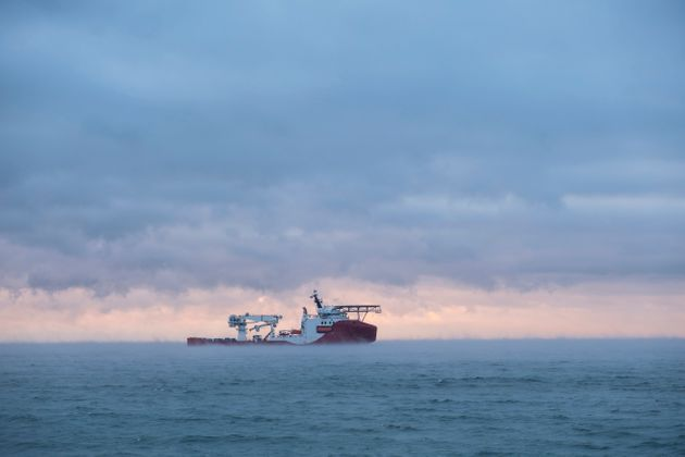Ship loading pipeline into the sea. Beautiful sea view at