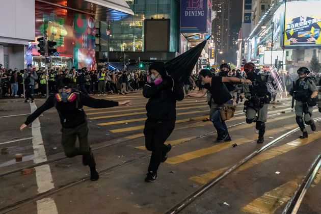 HONG KONG, CHINA - January 1: Riot police detain a protesters during a rally in Causeway Bay district...
