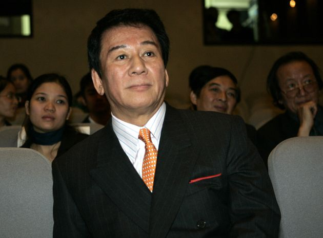 Ryotaro Sugi, goodwill ambassador between Japan and Vietnam listens to a speech prior to a film competition...