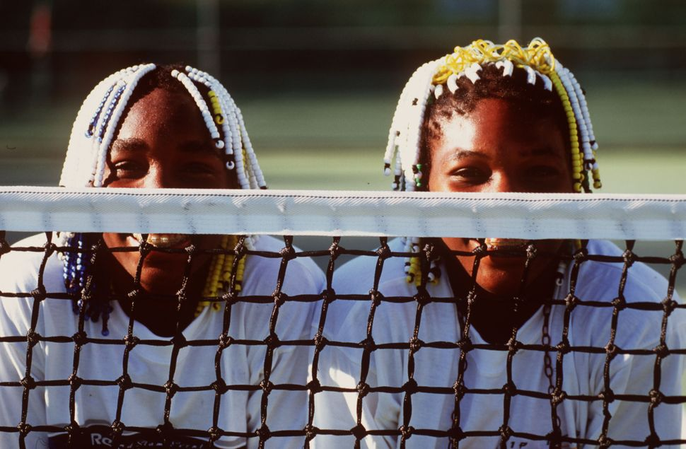 Teenagers Venus (left) and Serena Williams pose together during the Adidas International event in Sydney, Australia, on Jan.
