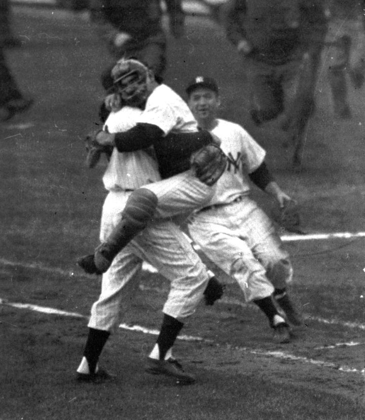 In this 1956 file photo, New York Yankees catcher Yogi Berra leaps into Don Larsen's arms at the end of Game 5 of baseball's