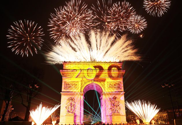 PARIS, Jan. 1, 2020 Fireworks illuminate the sky over the Arc de Triomphe during the New Year's celebrations...