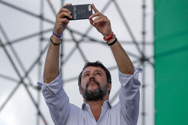 The League leader Matteo Salvini takes pictures from the stage as he addresses a rally in Rome, Saturday,...