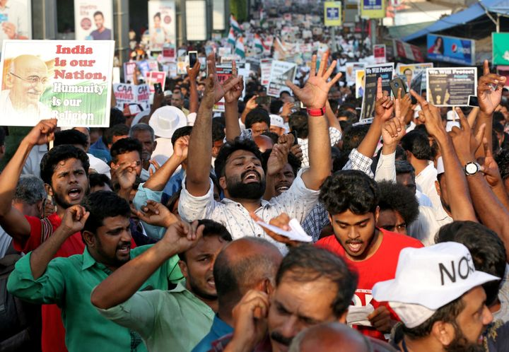 Demonstrators shout slogans as they attend the protest rally in Kochi.