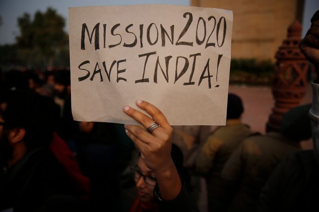 A student holds a placard during a protest against CAA in front of India Gate war memorial, in New Delhi,...
