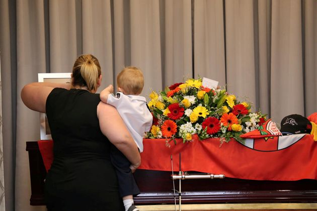Keaton's partner and son at his funeral on