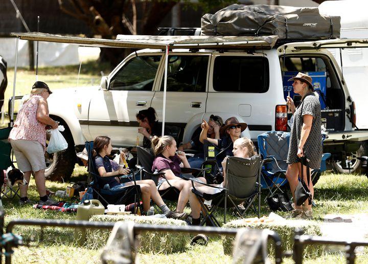 Locals congregate in an evacuation area.