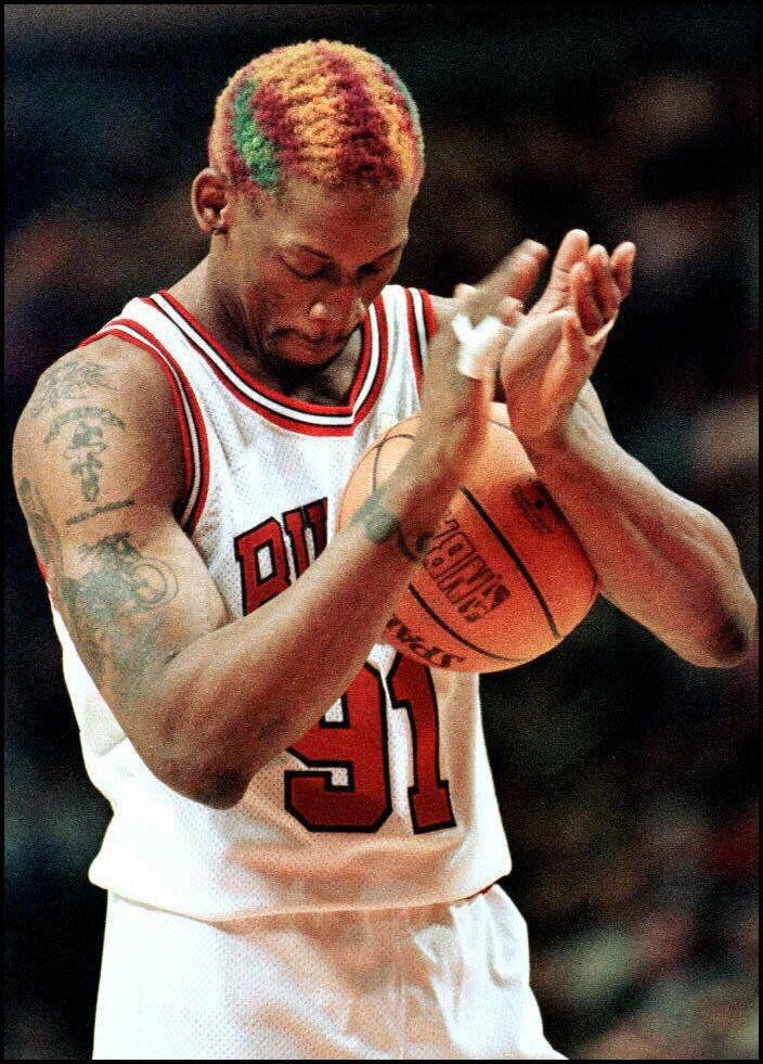 Chicago Bulls forward Dennis Rodman claps after making a free throw that sealed a victory against the Los Angeles Lakers in t