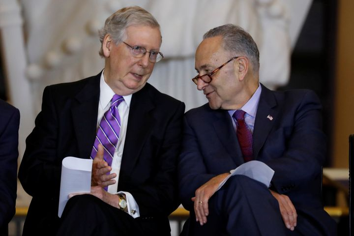 Senate Majority Leader Mitch McConnell and Senate Minority Leader Chuck Schumer talk during a ceremony in October 2017.