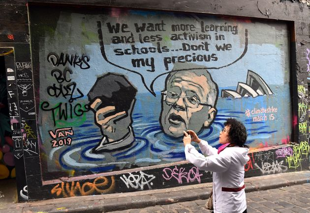 A mural showing Scott Morrison holding a lump of coal as it advertises a rally by students around the...