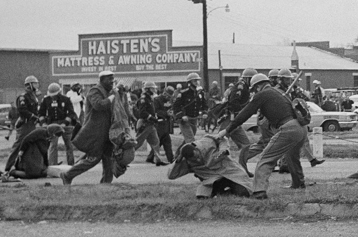 State troopers breaking up a voting rights march in Selma, Alabama, on March 7, 1965. In the foreground, John Lewis, then cha