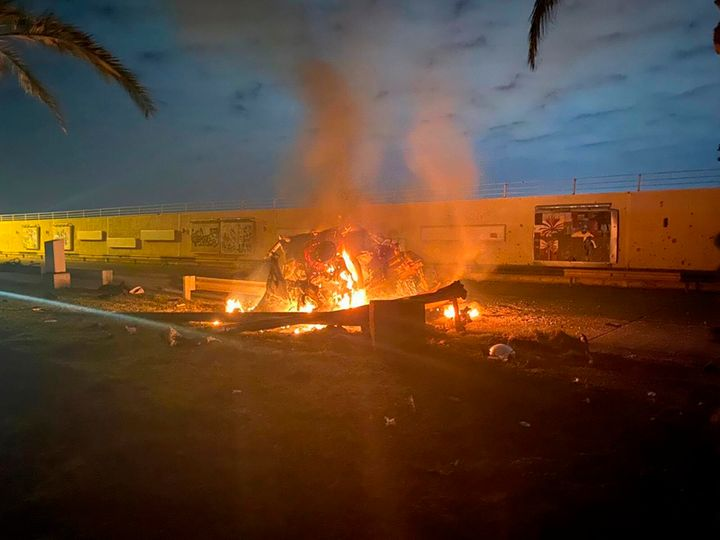 A vehicle burns at the Baghdad International Airport following an airstrike in early Friday. The Pentagon said Thursday that