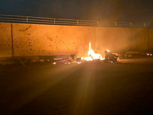 A photo released by the Iraqi prime minister's press office shows a burning vehicle at the Baghdad International...