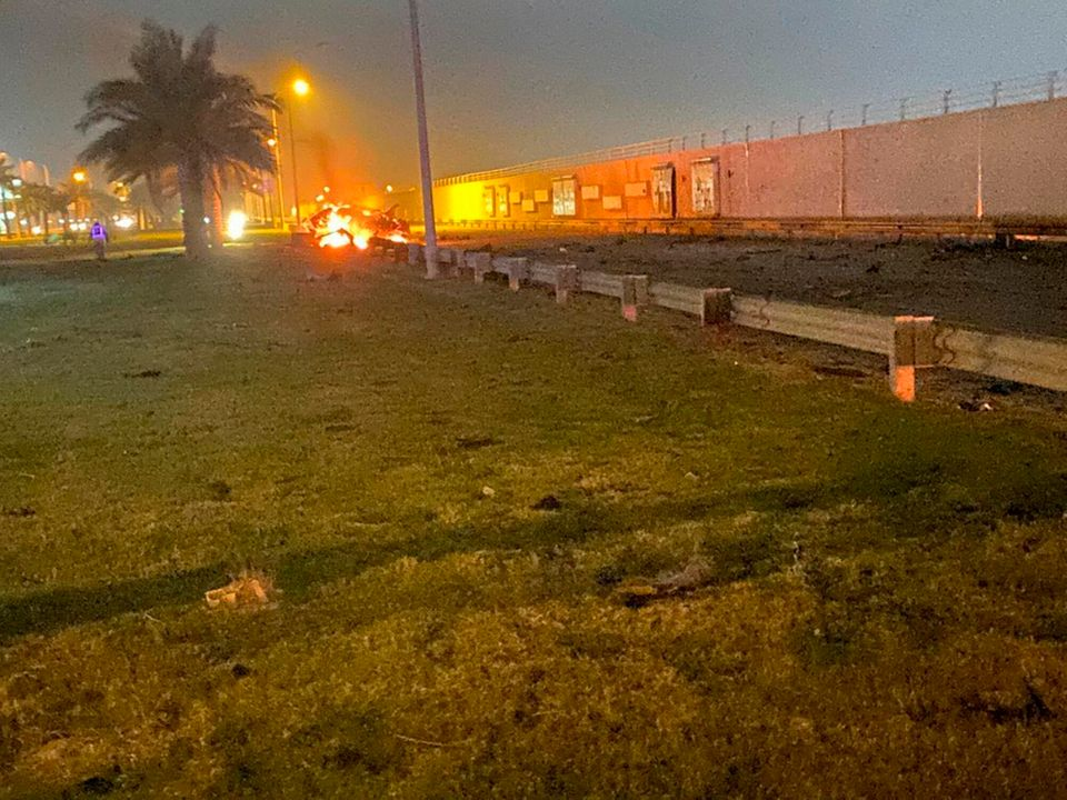 Photo released by the Iraqi prime minister's press office shows a burning vehicle at the Baghdad International...