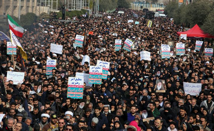 Iranians hold anti-U.S. banners during a demonstration in the capital Tehran on Jan. 3, following the killing of Iranian Revo
