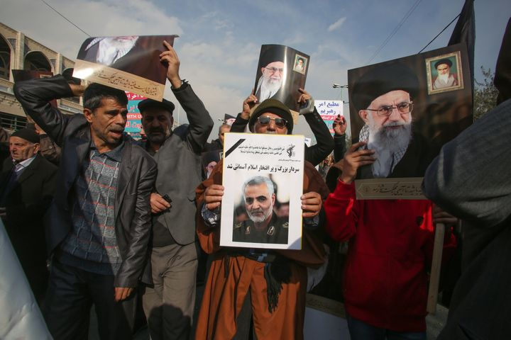 Iranians holds posters of Iran's supreme leader Ayatollah Ali Khamenei and Soleimani during a demonstration in Tehran.