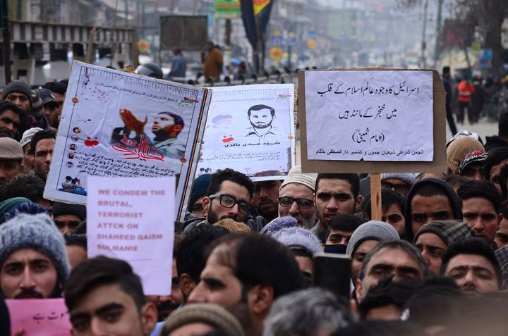 Shiite muslims shout anti-U.S. slogans as they protest in central Kashmir.
