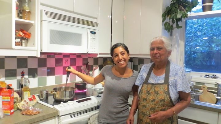 An adult Ishani and her Nani, left, in the kitchen.