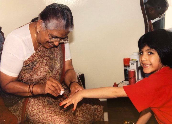 A young Ishani Nath, right, and her Nani, left, bond over nail polish.