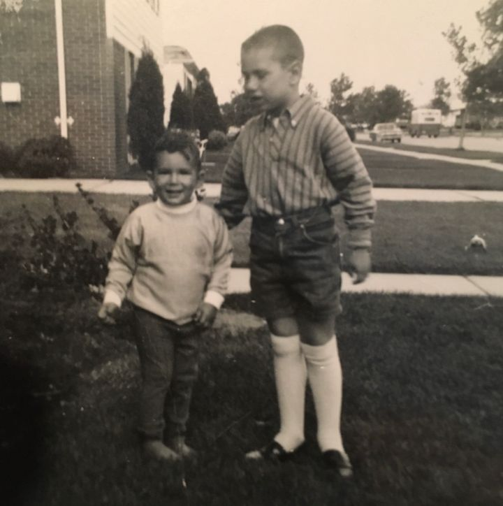 Stern (right) and his brother Lee (left) in front of their childhood home in Livonia, Michigan, in 1968.