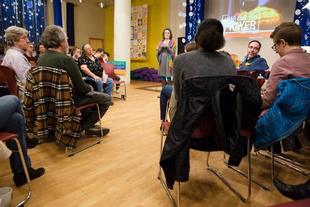 Rev. Sara Ewing-Merrill (center) leads Sunday service at HopeGateWay church in Portland, Maine, on March...