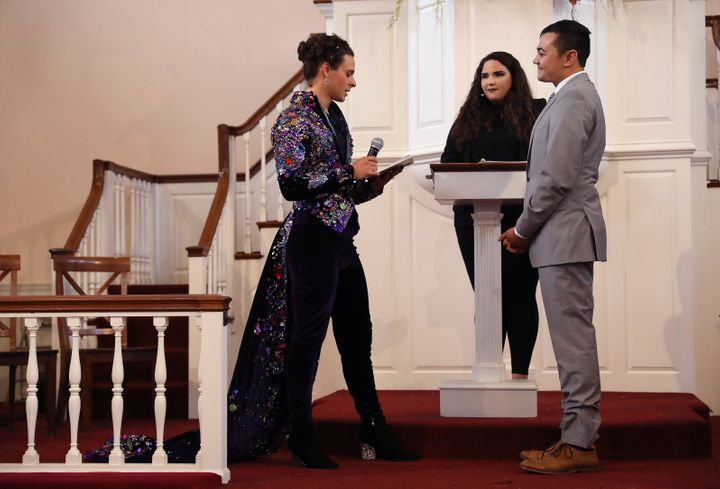 United Methodist Church minister Rev. Jordan Harris (right) and his partner Nathaniel Devarie are married at the Old West Chu