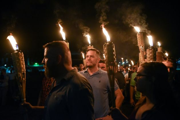White nationalists march on the grounds of the University of Virginia ahead of the Unite the Right Rally...