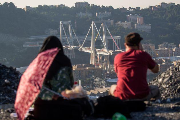People watch the collapsed Morandi Bridge, in Genoa, Italy, on June 28, 2019. The giant motorway bridge...