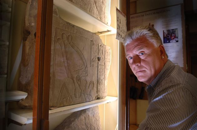 Medium and psychic Derek Acorah examines hieroglyphics on a stone tableau at the Petrie Museum of Egyptian...