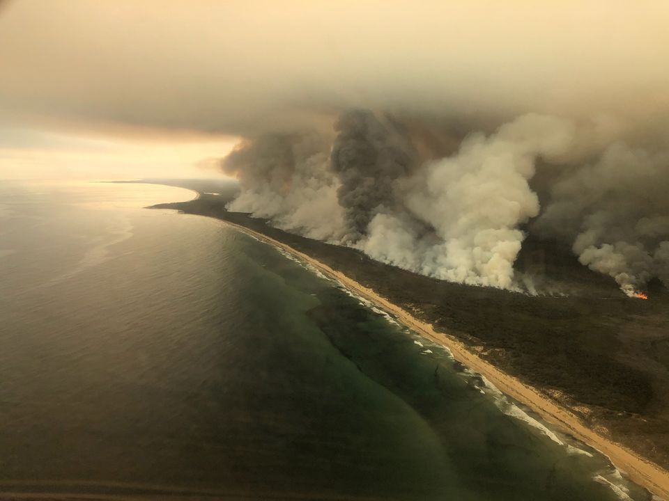 Thick plumes of smoke rise from bushfires at the coast of East Gippsland, Victoria, Australia, January...