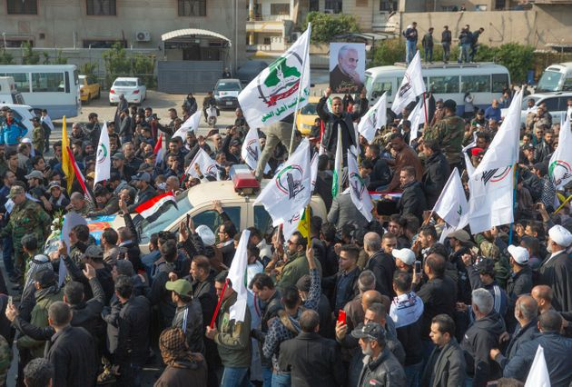 Mourners march during the funeral of Iran's top general Qassem Soleimani,