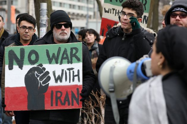 Demonstrators protest against war amid increased tensions between the United States and Iran in Toronto...