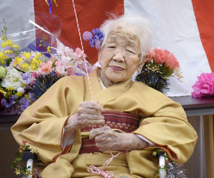 Kane Tanaka, born in 1903, smiles as a nursing home celebrates her 117th birthday in Fukuoka, Japan.