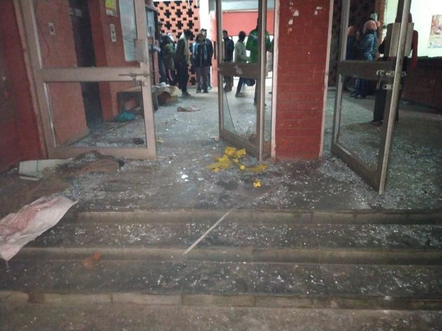 A view of the shattered glass door of Sabarmati Hostel,
